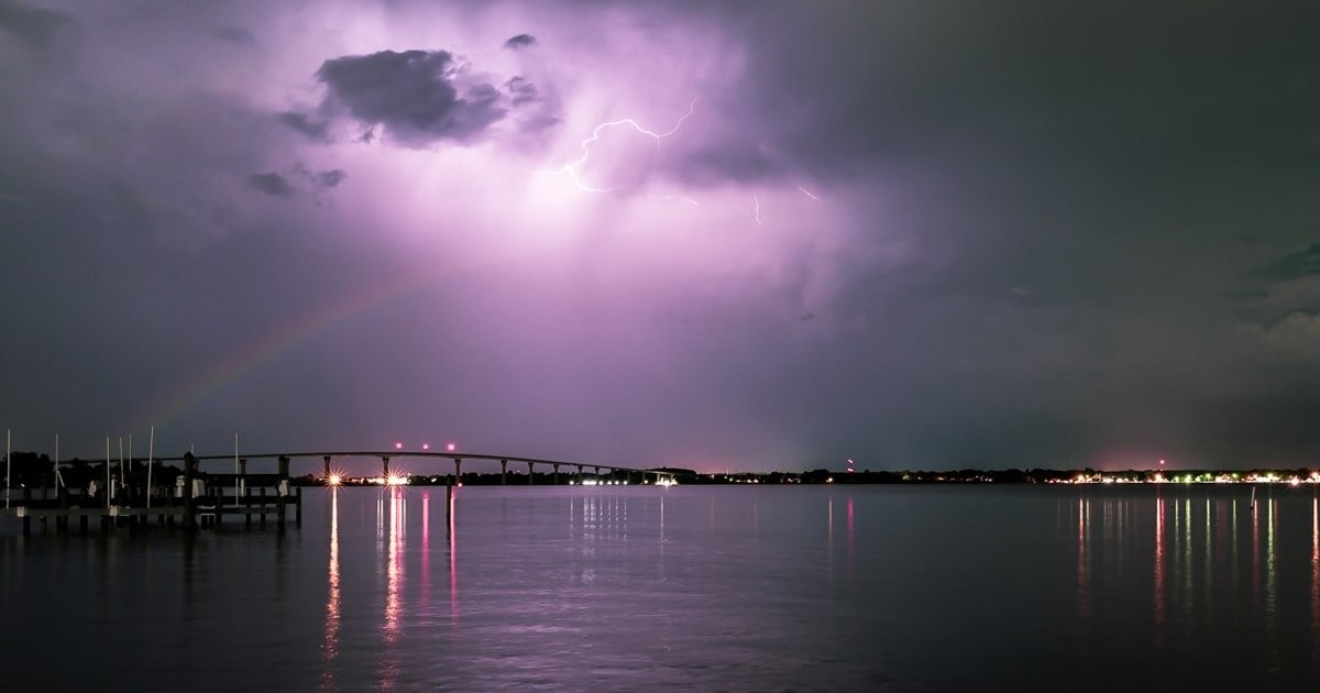 Photographer Captures Rare Sight of Double Moonbow Colliding With Bolt of Lightning